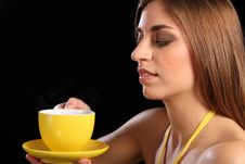 Free Beautiful Woman Holding Yellow Tea Cup And Saucer Royalty Free Stock Photo - 17987975