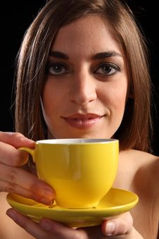 Beautiful Woman Holding Yellow Tea Cup And Saucer Stock Image