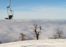 Ski Lift Above The Clouds Royalty Free Stock Image
