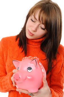 Young Woman Standing With Piggy Bank Royalty Free Stock Images