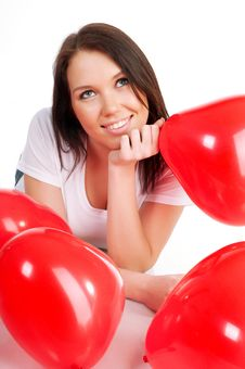 Young Brunette With Red Hearts Isolated Stock Photography