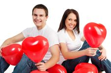 Couple With A Red Heart Royalty Free Stock Image