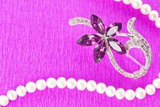Free Brooch And Pearl Necklace On Purple Background Stock Photo - 17995370