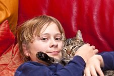Young Boy Is Hugging His Cat Stock Images