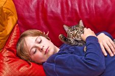 Young Boy Is Hugging His Cat Stock Photos