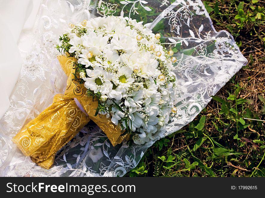Bridal bouquet on dress