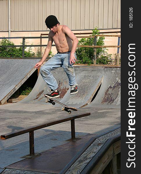 Skateboarder Landing on Rail