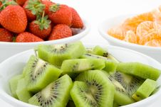 Free Kiwi, Strawberry And Mandarine, Tangerine In White Bowls Royalty Free Stock Photography - 1802297
