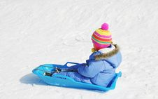 Child On Sled Royalty Free Stock Photos