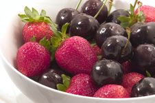 Strawberries And Cherries Stock Images