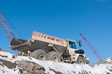 Dump Truck On A Construction Site In Winter Royalty Free Stock Photo