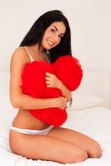 Woman At Home Hugging A Big Fluffy Soft Heart Stock Photography