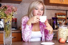 Free Woman Sniffing The Scent Cup Of Hot Drink Stock Images - 18003074