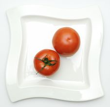 Free Two Tomatoes On Plate. Stock Photography - 18005172