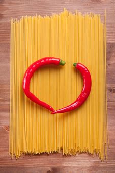 Chili Pepers On The Spaghetti Stock Photos