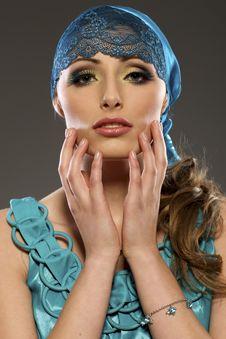 Beautiful Blond Model In Blue Lucid Dress Stock Image