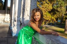 Woman In Green Clothes Smile On Autumn Sunset Royalty Free Stock Photography