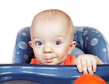 Small Beautiful Baby Boy In A Baby Chair Stock Photo