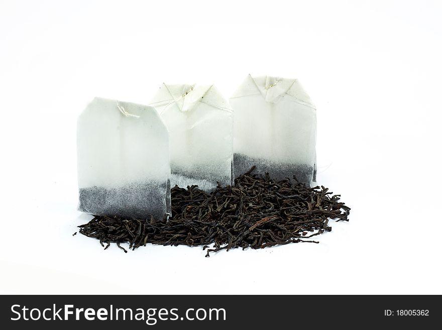 Tea bags and dried tea leaves