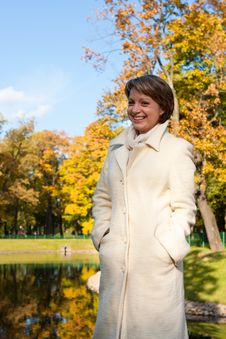 Charming Young Woman In An Autumn Park Stock Images