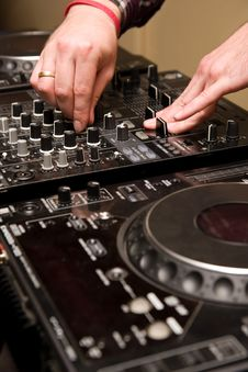 Free Hands Of A Dj Playing Music Stock Photos - 18014873