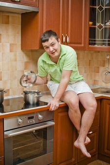 Young Handsome Guy In The Kitchen Stock Photography