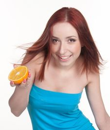 Free A Redhead Woman With An Orange Royalty Free Stock Photo - 18016515