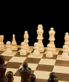 Free Chess Piece On Board Isolated On Black Stock Photo - 18016550