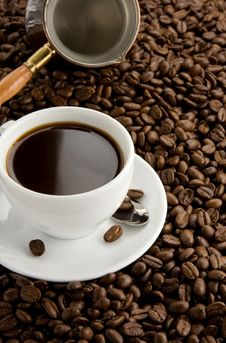 Cup Of Coffee And Pot On Beans Stock Image