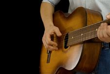 Guitar And Man On Black Royalty Free Stock Photos