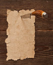Free Old Paper Pinned To A Wooden Wall Stock Image - 18029051