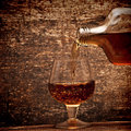 Free Cognac Pour From A Bottle In A Glass Stock Images - 18029564