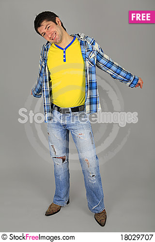 Free Man In Jeans And A Plaid Shirt And A Yellow T-shir Royalty Free Stock Photography - 18029707