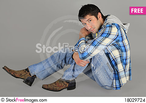 Free Man In Jeans And A Plaid Shirt Stock Images - 18029724