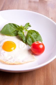 Fried Egg With Tomato Stock Photos