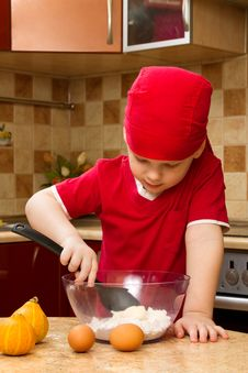 Free Small Boy In Kitchen With Baking Stock Image - 18028121