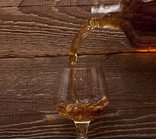 Free Cognac Pour From A Bottle In A Glass Stock Photo - 18029490