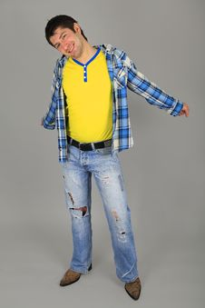 Man In Jeans And A Plaid Shirt And A Yellow T-shir Royalty Free Stock Photography
