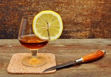 Free Classic Cognac With Lemon And Knife Stock Image - 18029971
