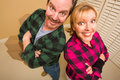 Free Proud Goofy Couple And Moving Boxes In Empty Room Royalty Free Stock Photography - 18030747
