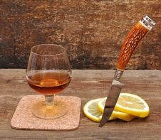 Free Classic Cognac With Lemon And Knife Stock Image - 18030061