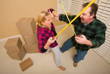 Free Couple Having Fun Sword Fight With Tape Measures Royalty Free Stock Images - 18030829