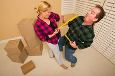 Free Couple Having Fun Sword Fight With Tape Measures Stock Image - 18030831