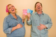 Free Pregnant Couple Deciding On Pink Of Blue Paint Stock Photos - 18030853