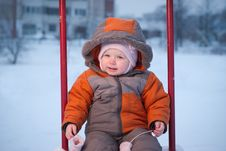 Free Baby Sit On Swing, Taking Out The Mittens Stock Photo - 18032850