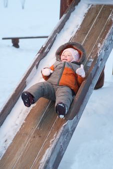 Baby Sliding Down The Slides For Children Royalty Free Stock Photos