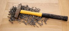 Free Pile Of Old Screws And A Hammer Stock Photography - 18033682