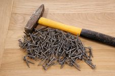 Free Pile Of Old Screws And A Hammer Stock Photos - 18033693