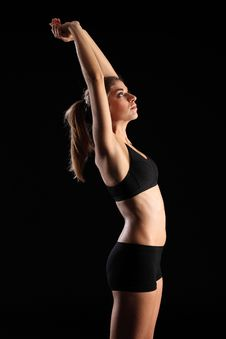 Woman In Sports Outfit Stretching Arms Above Head Royalty Free Stock Images