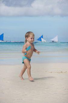 Free Child Playing On Beach Stock Photo - 18036860